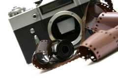 Roll of film strip, and old film camera Royalty Free Stock Image