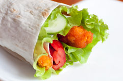 Roll with fish fingers in  pita Royalty Free Stock Photography