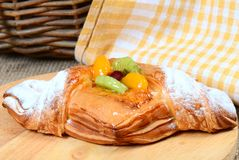 Roll from flaky pastry with fruit Royalty Free Stock Photos