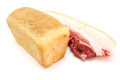 Roll of fresh bread and the big piece Stock Photos