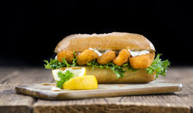 Roll with fried Fish Sticks (close-up shot) Royalty Free Stock Photography