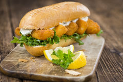 Roll with fried Fish Sticks (close-up shot) Stock Images