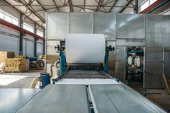 Roll of galvanized steel or metal on machine in industrial workshop on rolling mill, manufacturing metalwork factory stock photos