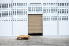 Roll garage gate and old wooden pallet Royalty Free Stock Photography
