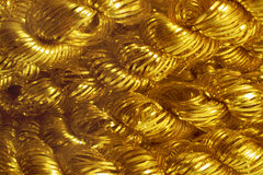 A roll of gold tinsel for the Christmas tree. Closeup Royalty Free Stock Photo