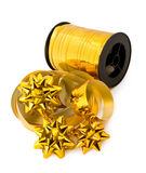 Roll of golden ribbons and bows Royalty Free Stock Photography