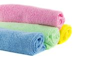 Roll of green, blue, pink and yellow towels Stock Photo