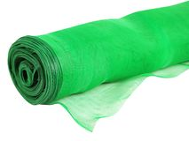 Roll of green mosquito net isolated on white stock photography