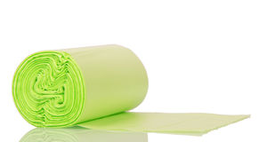 Roll of green plastic garbage bags isolated on white background. Royalty Free Stock Photography