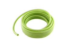 Roll of green pvc garden hose Royalty Free Stock Photography