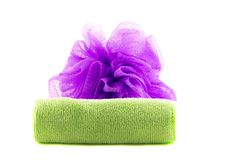 Roll of green towel with purple sponge. A roll of green towel with purple sponge on a white background Stock Photo