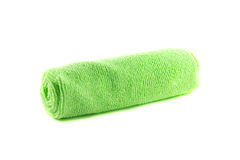 A roll of green towel. On a white background Royalty Free Stock Images