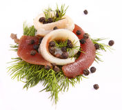 Roll with herring.Herring on pertse.esklyuziv dish of ryby.File capelin. Preservation of Herring. Herring on a red pepper. Herring fillet on sweet peppers Stock Photography