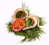Roll with herring.Herring on pertse.esklyuziv dish of ryby.File capelin. Preservation of Herring. Herring on a red pepper. Herring fillet on sweet peppers Stock Image