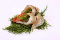 Roll with herring.Herring on pertse.esklyuziv dish of ryby.File capelin. Preservation of Herring. Stock Image
