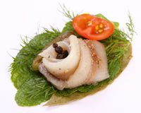 Roll with herring.Herring on pertse.esklyuziv dish of ryby.File capelin. Preservation of Herring. Stock Photo
