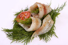 Roll with herring.Herring on pertse.esklyuziv dish of ryby.File capelin. Preservation of Herring. Royalty Free Stock Photo