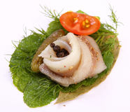 Roll with herring.Herring on pertse.esklyuziv dish of ryby.File capelin. Preservation of Herring. Royalty Free Stock Image