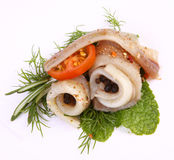 Roll with herring.Herring on pertse.esklyuziv dish of ryby.File capelin. Preservation of Herring. Royalty Free Stock Images