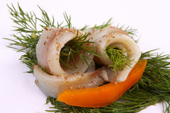 Roll with herring.Herring on pertse.esklyuziv dish of ryby.File capelin. Preservation of Herring. Royalty Free Stock Photography