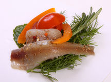 Roll with herring.Herring on pertse.esklyuziv dish of ryby.File capelin. Preservation of Herring. Royalty Free Stock Photos