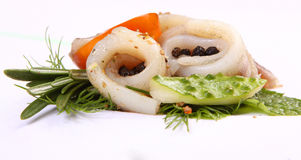Roll with herring.Herring on pertse.esklyuziv dish of ryby.File capelin. Preservation of Herring. Stock Photography