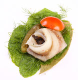 Roll with herring.Herring on pertse.esklyuziv dish of ryby.File capelin. Preservation of Herring. Stock Photos
