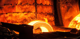 Roll of hot metal on the conveyor belt Royalty Free Stock Images