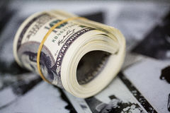 Roll a hundred dollar bill. American money banknote Stock Photos