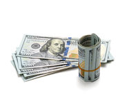 Roll hundred dollar bills on  white background Royalty Free Stock Images
