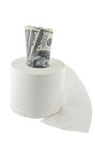 Roll of hundred dollars in a toilet paper Stock Photo