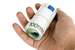 Roll of hundred euro isolated in hand Stock Images