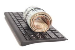 Roll of Indian Currency Rupee Notes on computer keyboard Royalty Free Stock Image
