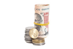 Roll of Indian Currency Rupees Notes and Coins Stock Photo