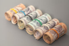 Roll of Indian rupee banknotes. On gray Royalty Free Stock Photos