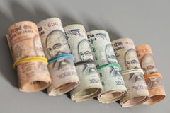 Roll of Indian rupee banknotes. On gray Stock Images