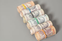 Roll of Indian rupee banknotes. On gray Royalty Free Stock Photography