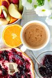 Roll with jam, coffee and fruits Royalty Free Stock Photos