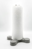 Roll of kitchen paper towel standing on grey plastic holder Stock Photos