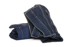 Roll light blue jeans closeup royalty free stock images