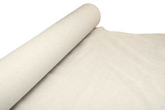 Roll of a linen fabric. The linen fabric is unwound from a roll Stock Photography