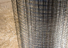 Roll loose shiny thin wire grating. Roll loose shiny thin steel wire grating Royalty Free Stock Photos