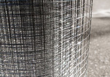 Roll loose shiny thin wire grating. Roll loose shiny thin steel wire grating Royalty Free Stock Photography