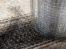 Roll loose shiny thin wire grating. Roll loose shiny thin steel wire grating Stock Images