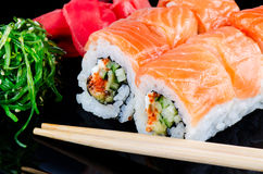 Roll made of salmon Stock Images
