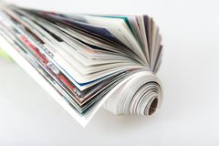 Roll magazin. Front view of roll magazine, colored newspaper on white background stock photography
