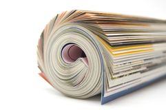Roll of magazine. Closeup on white royalty free stock photography