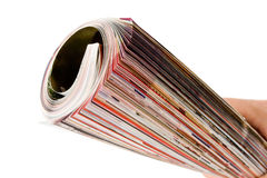 Roll of magazine in hand Stock Photography