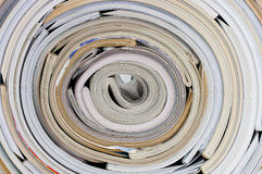 Roll of magazines. A big roll of more than 30 magazines stock images