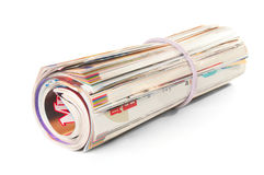 Roll of magazines. On white background stock image